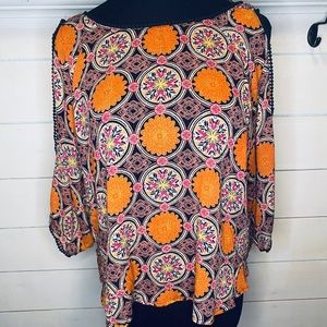 Open arm, open back floral orange shirt